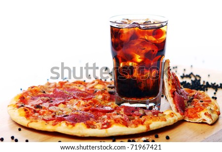 Fresh pizza with salami and mushrooms and cold cola drink