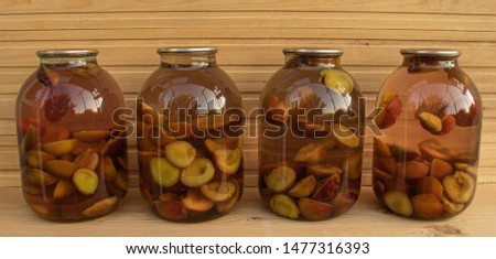 Fresh plum compote on wooden background freshly cooked
