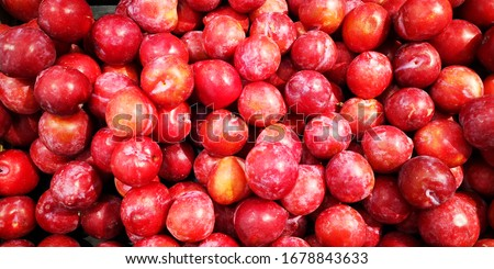 fresh plums in a pile