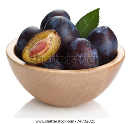 fresh plums in bowl isolated
