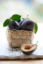 fresh plums in the basket