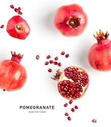 Fresh pomegranate creative layout isolated on white background. Healthy eating and dieting food concept. Winter fruits and berries composition. Top view, flat lay, design elements