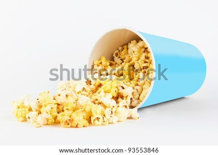 fresh popcorn in container on a white