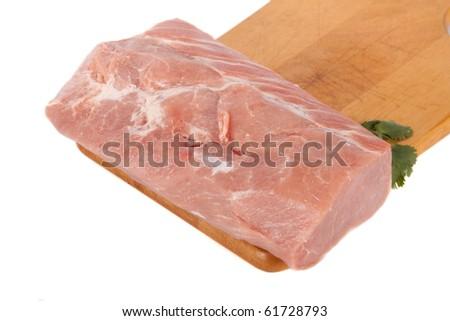 Fresh pork meat on wooden board