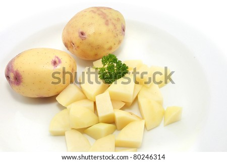 Fresh Potatoes with cut or diced isolated on white
