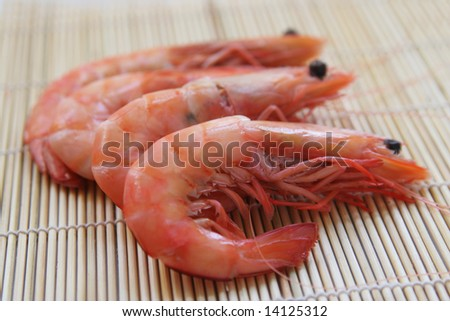 Fresh prawns on a bamboo surface