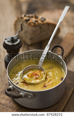 Fresh pumpkin soup on wooden table close up