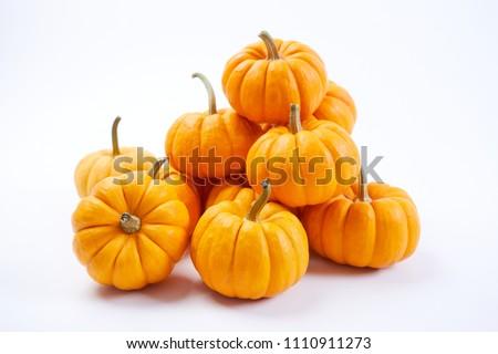 fresh pumpkins on white