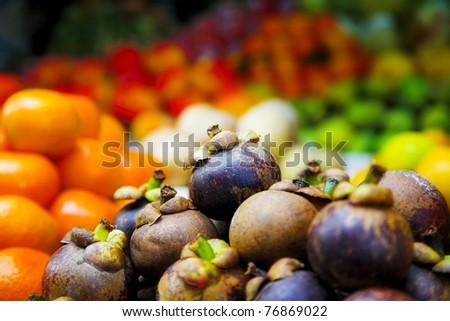 fresh purple mangosteen in the tropical market
