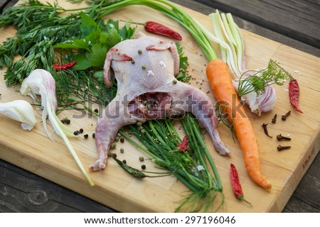 Fresh quail with garlic, carrots, green peppers and herbs to fragrant broth