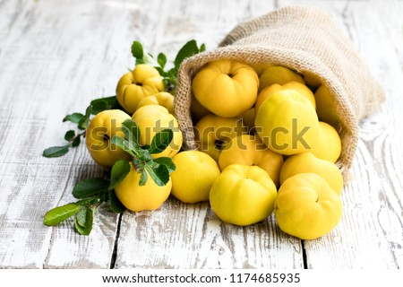 Fresh  quince fruits on white wooden table  #1174685935