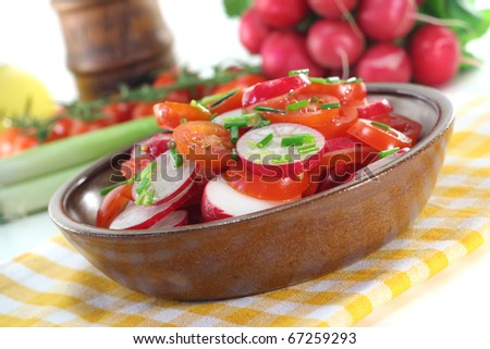 fresh radish and tomato salad with chives