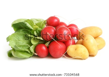 Fresh radishes and potatoes on a white background