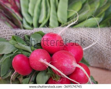 Fresh radishes on old  table #369574745