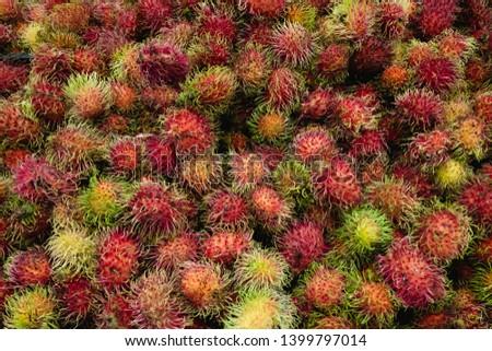 Fresh Rambutan red fruit background Red peel of rambutan Delicious rambutan Healthy red Healthy fruits rambutans in a supermarket local market of rambutans ready to eat sweet Thai fruit