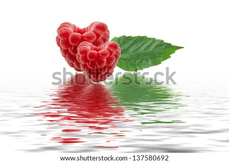 fresh raspberries and leaf with reflection in water