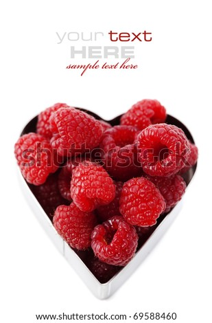 fresh raspberries in a heart shape representing love and valentines day images (easy removable text)