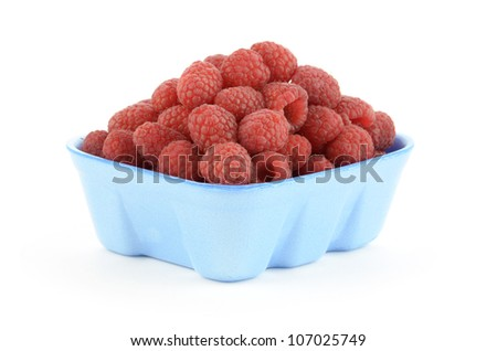 Fresh raspberries in blue styrofoam basket on white background