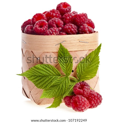 fresh raspberries in the wooden basket close up isolated on white background