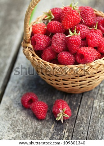 fresh raspberry in a basket on wooden table