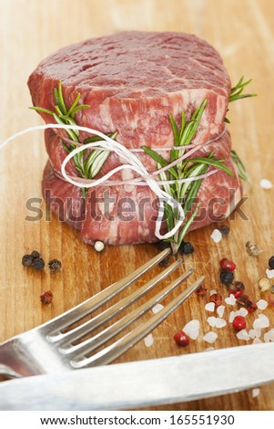 fresh raw beef fillet mignon on old  wooden background