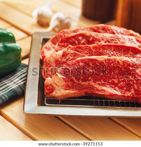 Fresh raw beef on kitchen table - stock photo