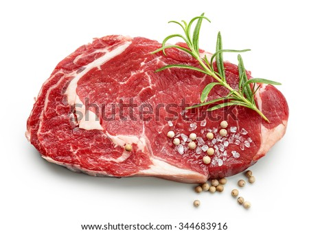 fresh raw beef steak with spices isolated on white background, top view