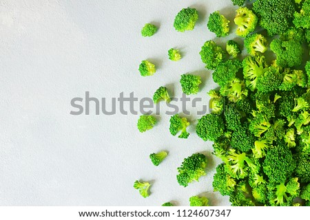 Fresh raw broccoli with copy space on grey background - summer healthy concept
