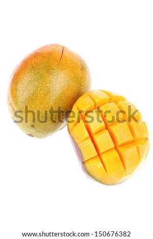 fresh raw carved mango isolated over white background