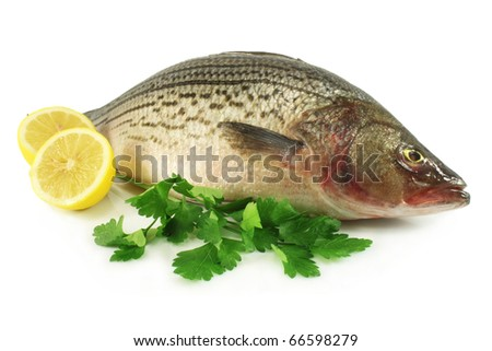 Fresh, raw fish with lemon and parsley