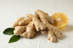 Fresh raw ginger and lemon on white background