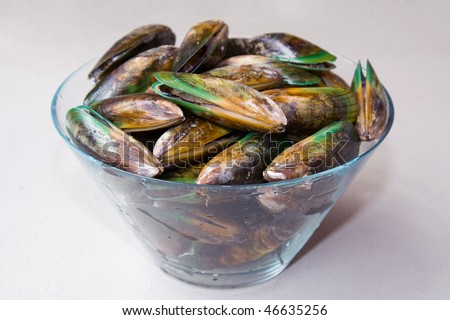 fresh raw green new zeland mussels heap in bowl side view cooking seafood