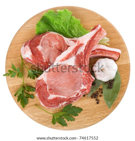 Fresh raw meat decorated with herbs and spices isolated on white background