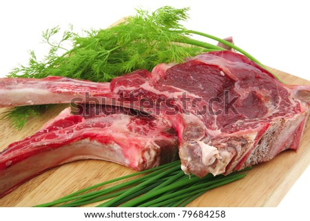 fresh raw meat : fresh red beef ribs with dill and green sprouts on wooden board isolated over white background