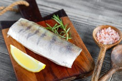 Fresh raw pike perch fish fillet on cutting board