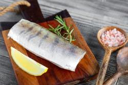 Fresh raw pike perch fish fillet on cutting board