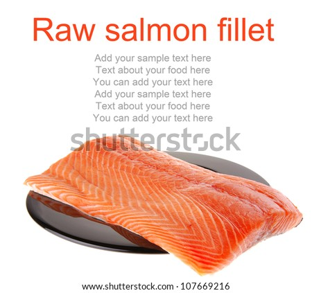 fresh raw salmon fillet on black over white