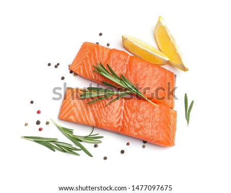 Fresh raw salmon fillets with rosemary and lemon on white background, top view