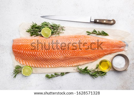 Fresh raw salmon or trout sea fish fillet with spices and herbs on white background, top view Сток-фото ©