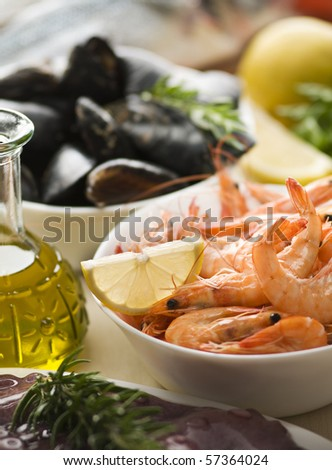 Fresh raw seafood with herbs close up shoot