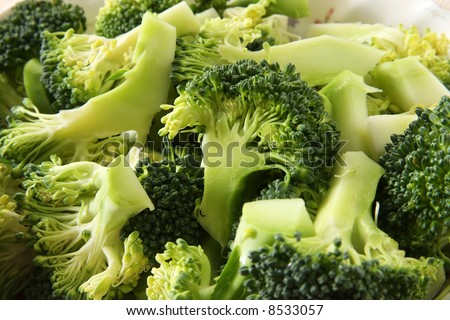 Fresh raw sliced broccoli pieces closeup segments