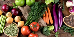 Fresh raw vegetables and legumes on wooden background. Bio Healthy food concept.Top view