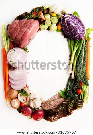 Fresh Raw Vegetables and Meats Shaped into Number Zero or Letter O