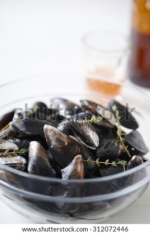 Fresh raw west coast mussels in a bowl ready for cooking