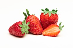 Fresh, red and tasty strawberries isolated on a white background