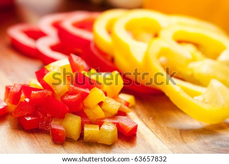 Fresh red and yellow peppers sliced into rings as well as diced