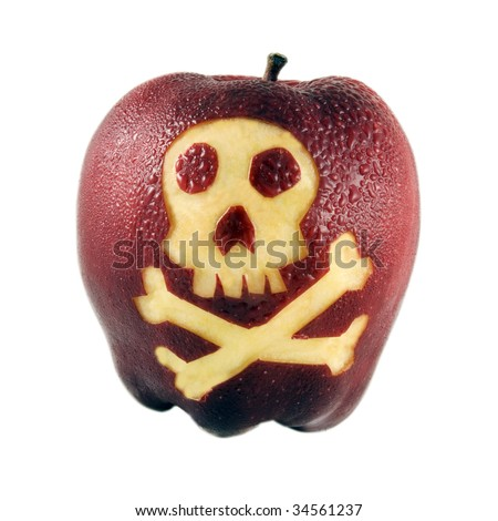Fresh red apple carved with skull & crossbones symbol - stock photo