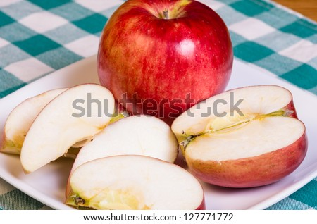 Fresh red apple sliced on a plate