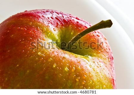 fresh red apple with water drops, close-up - stock photo