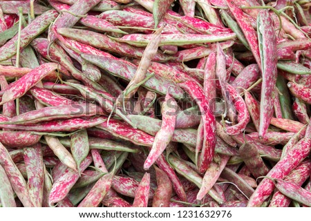 Fresh red beans (roman beans) as background on market stall Сток-фото ©